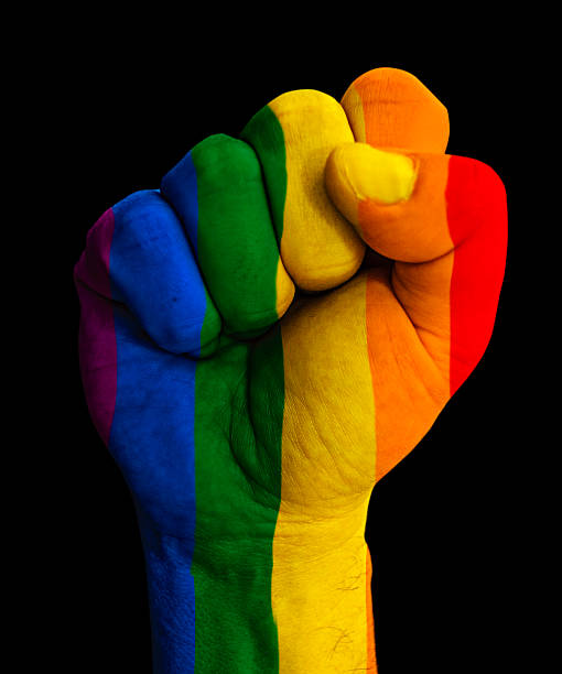 Gay flag pinted on fist.